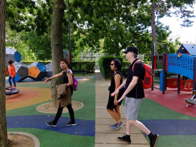 Playground park in Paris with three people walking