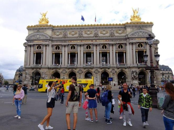 Palais Garnier in Paris with tourists outside