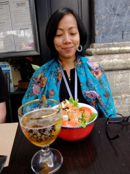 Girl with salmon salad and beer