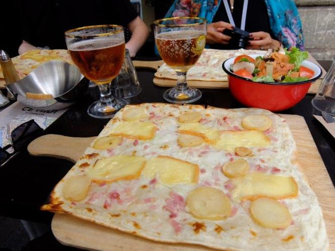 Flammekueche La Raclette flatbread with cheese potatoes bacon