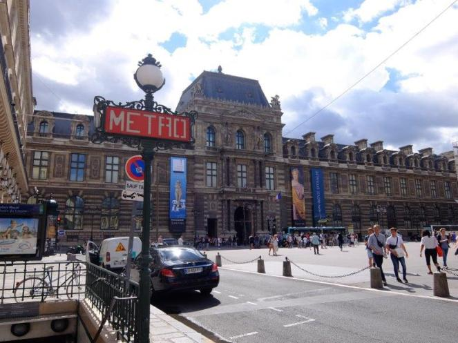 Louvre museum with metro stop in front