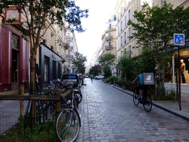A street in Le Marais guy cycling