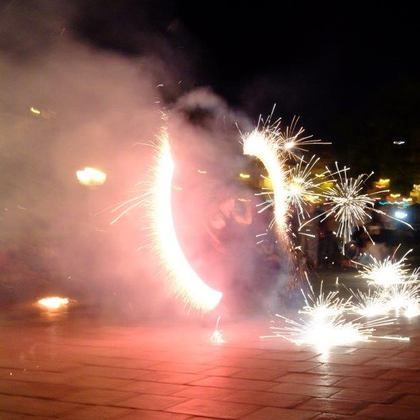 male street performer uses fireworks
