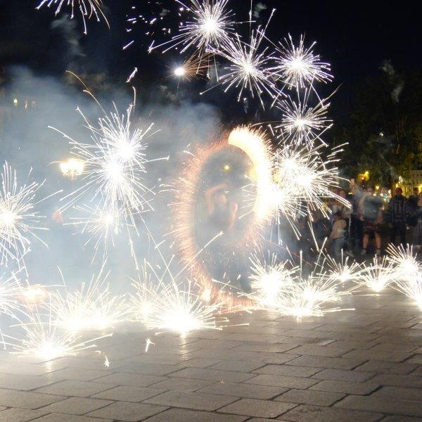 male street performer with fireworks all over him
