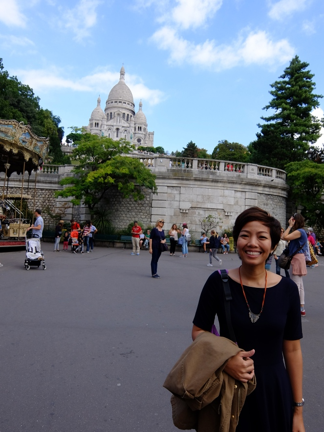 Girl in front of Sacre Coeur and carousel