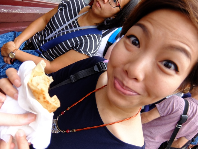 Girl eating lemon crepe