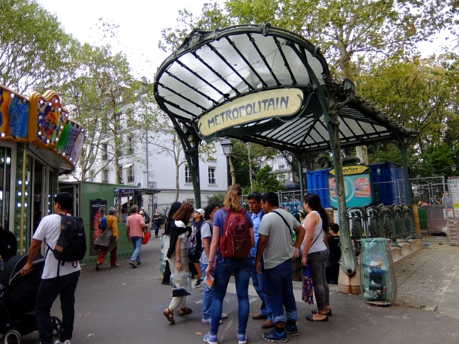 Paris metro stop in front of carousel
