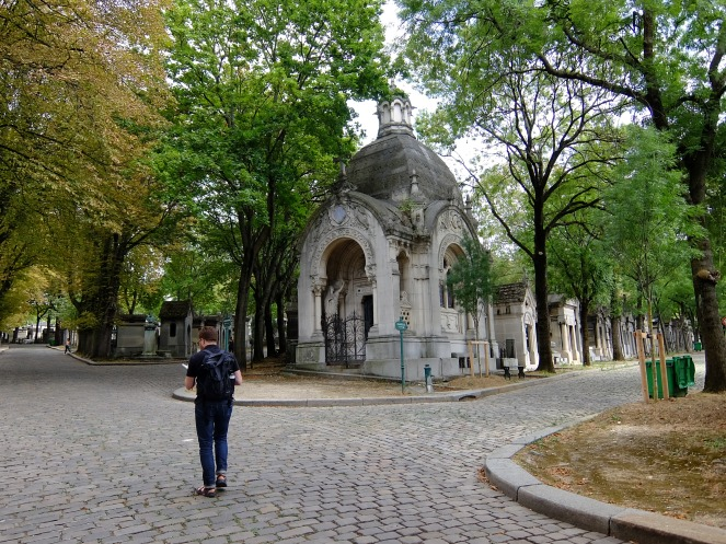 Man walking in Pere Lachaise cemetery
