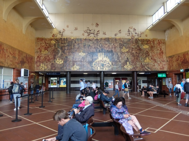 Bruges train station with tourists waiting