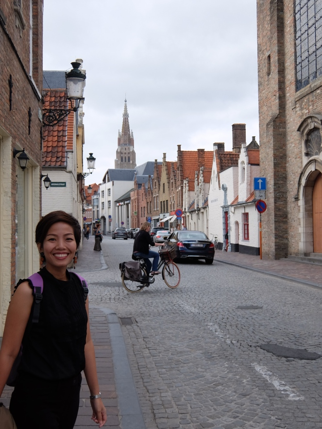 Girl walking on a street in bruges