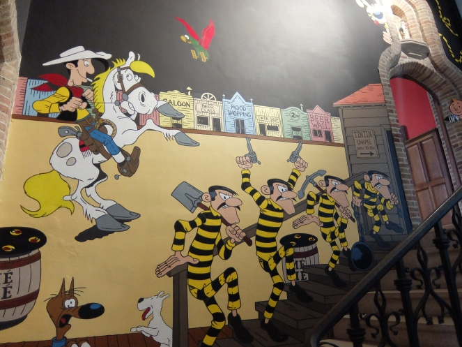 mural of comic characters consisting of thiefs in yellow and black outfits