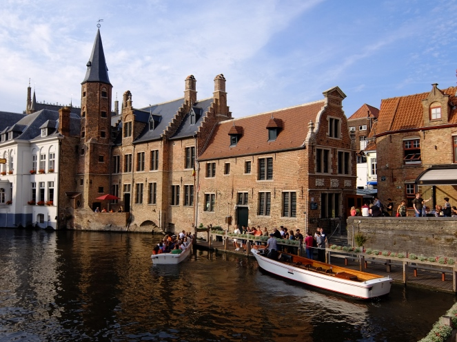 Tourists waiting to get on to a cruise boat in Bruges