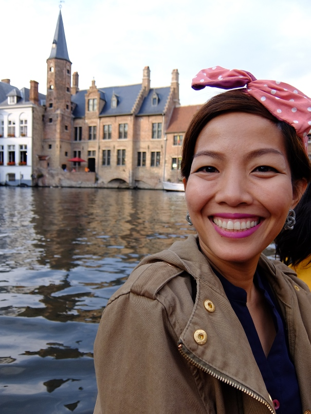 girl with headband on a cruise in bruges
