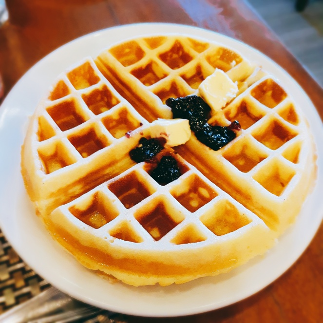 Waffle with blueberry jam and butter