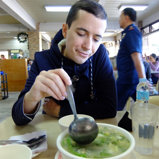 Guy having a bowl of noodle soup