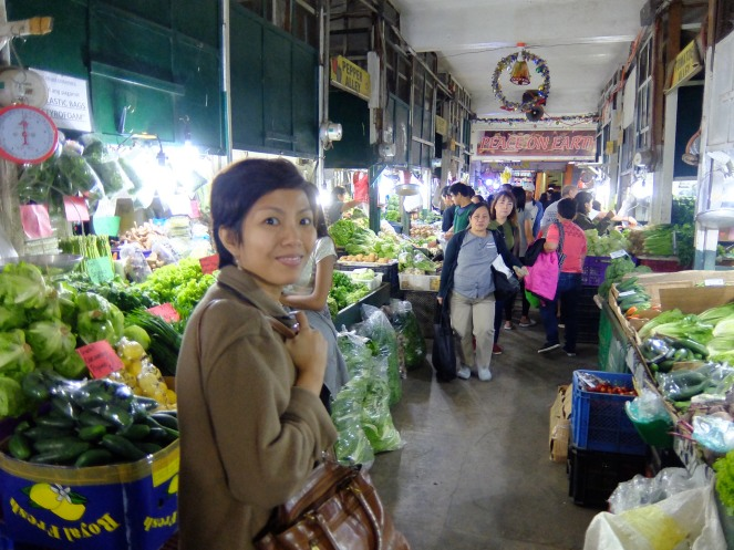 Girl inside vegetable market looking at camera
