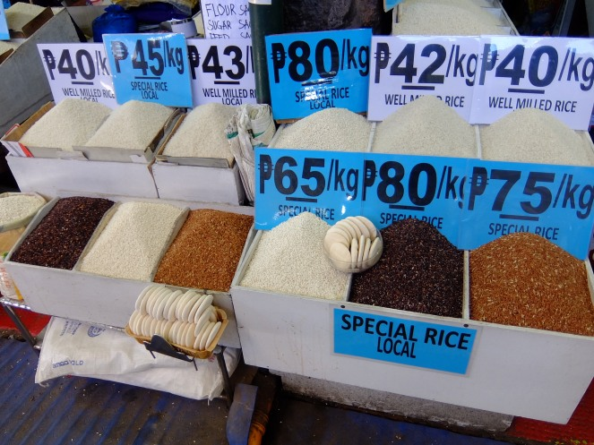 Different kinds of rice with price signs