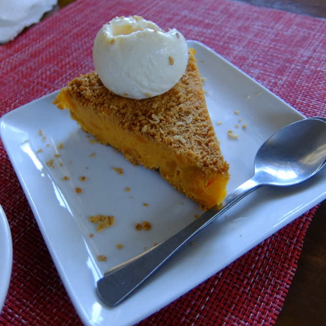 Sweet potato pie topped with vanilla ice cream