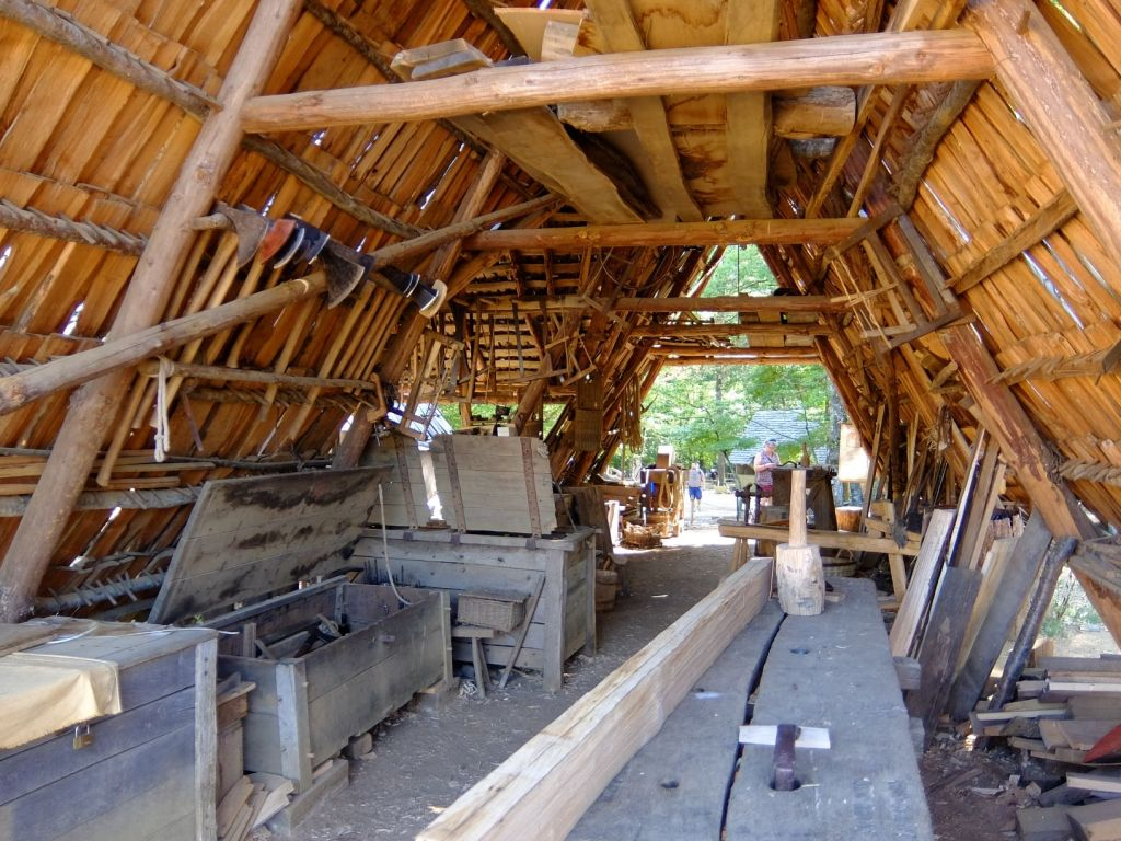 a wooden shed filled with carpentry tools