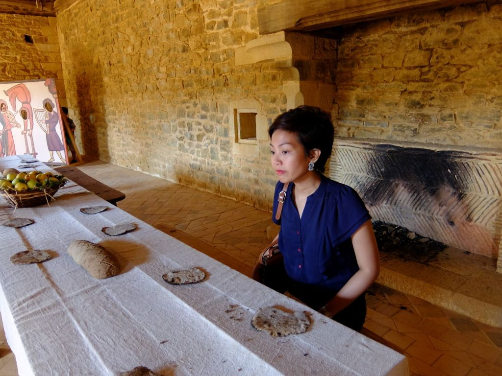 girl looking at table with dry bread on it