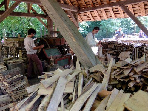 2 men preparing wooden shingles