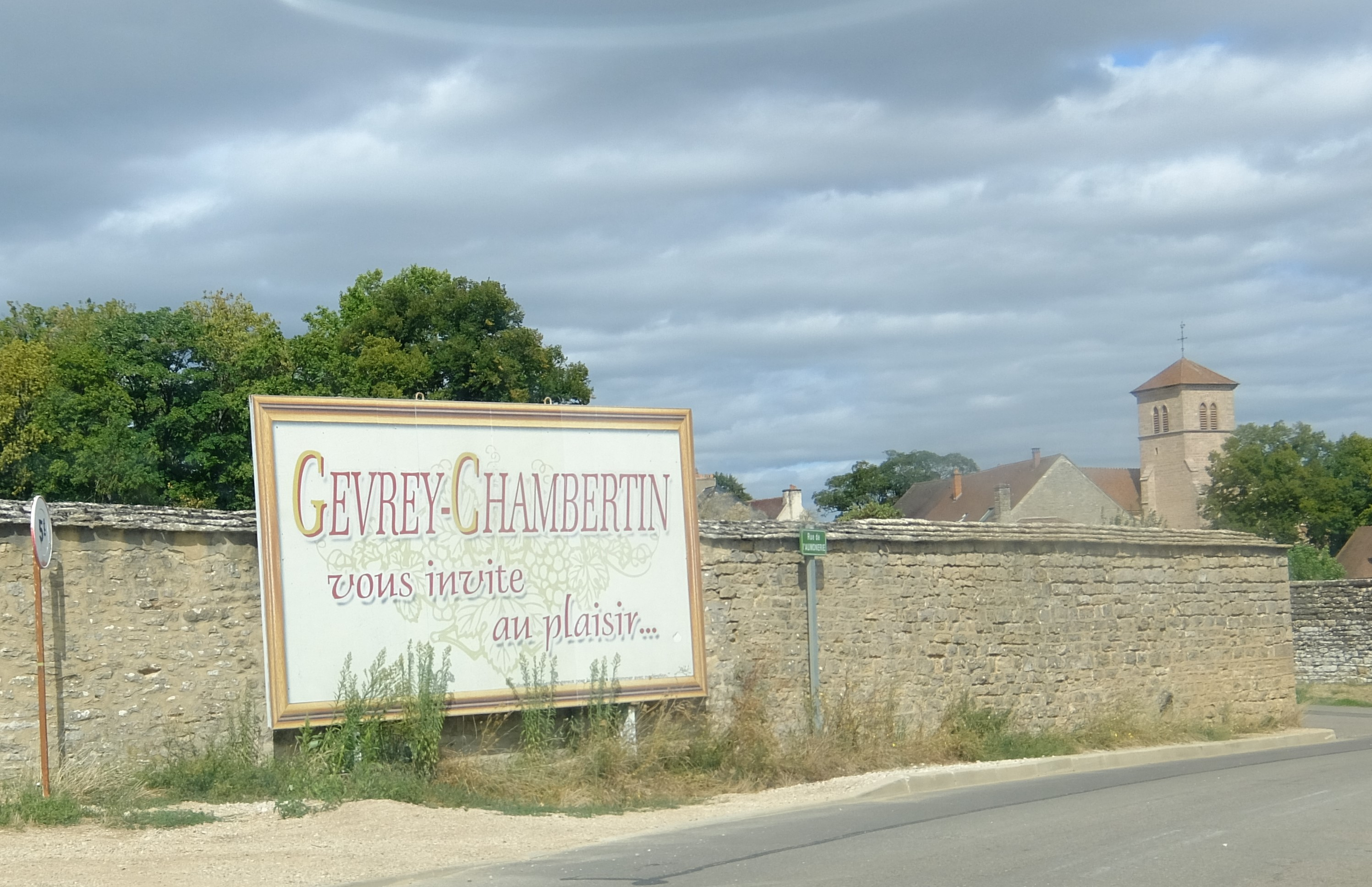 sign along road which says Gevrey-Chambertin vous invite au plaisir