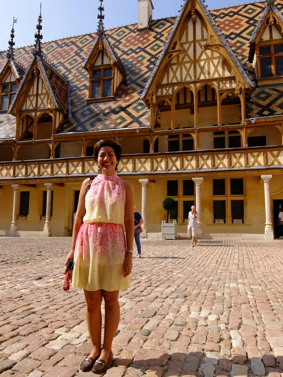 girl standing in courtyard of hospices de beaune