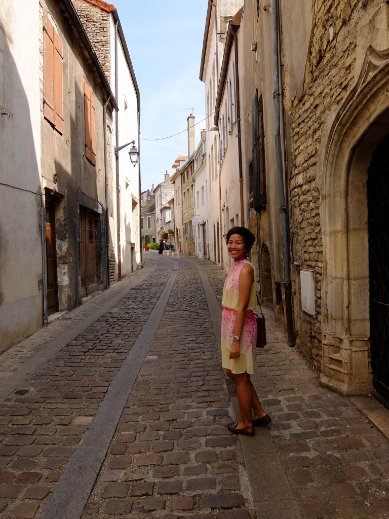 girl walking in the streets of beaune
