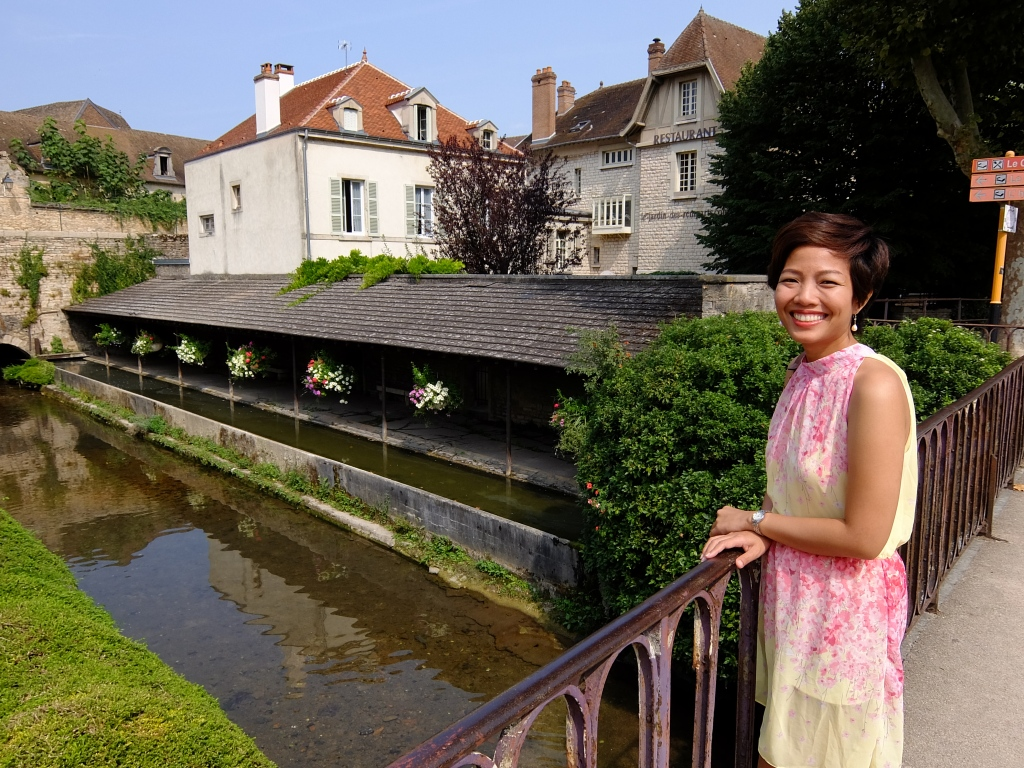 girl overlooking a small bridge in Beaune