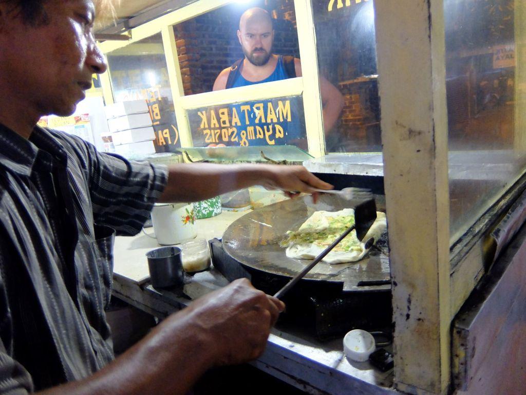 A man making Martabak in Indonesian night market