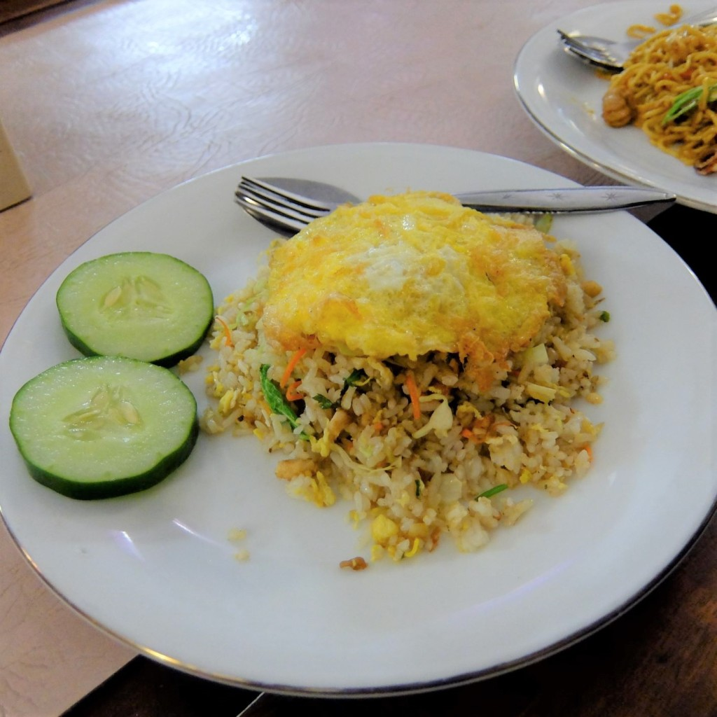 Plate of Indonesian fried rice with egg on top