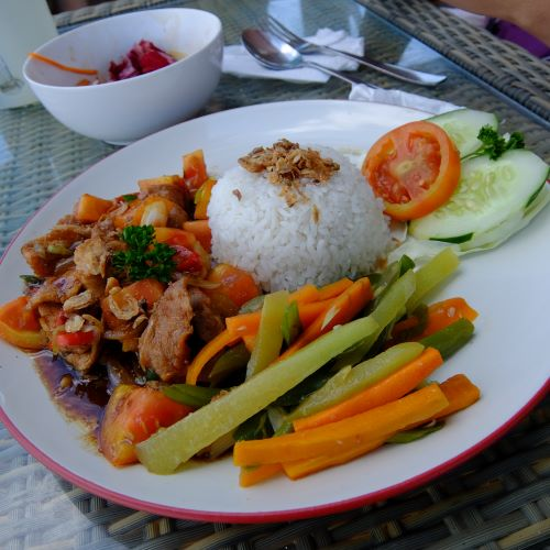 plate of pork and veggies in Indonesian sauce kecap manis