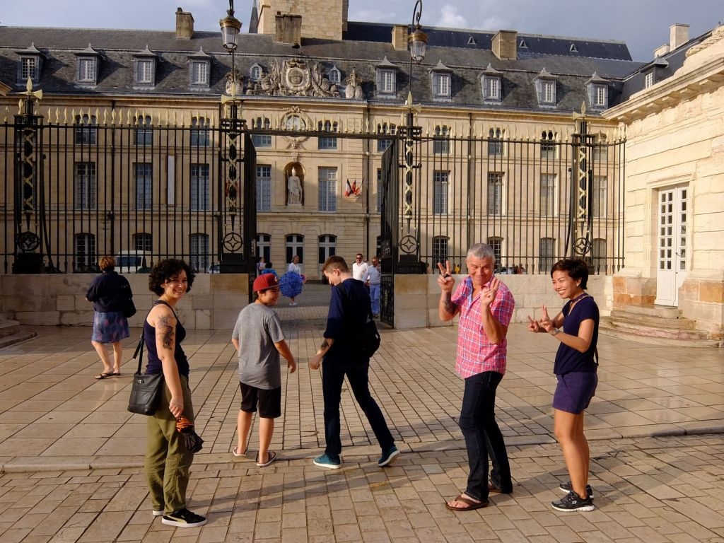 tourists in front of the Dukes' Palace in Dijon
