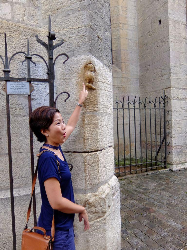 woman rubbing the lucky owl in Dijon