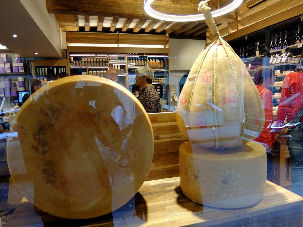 Big cheeses at store shop windown