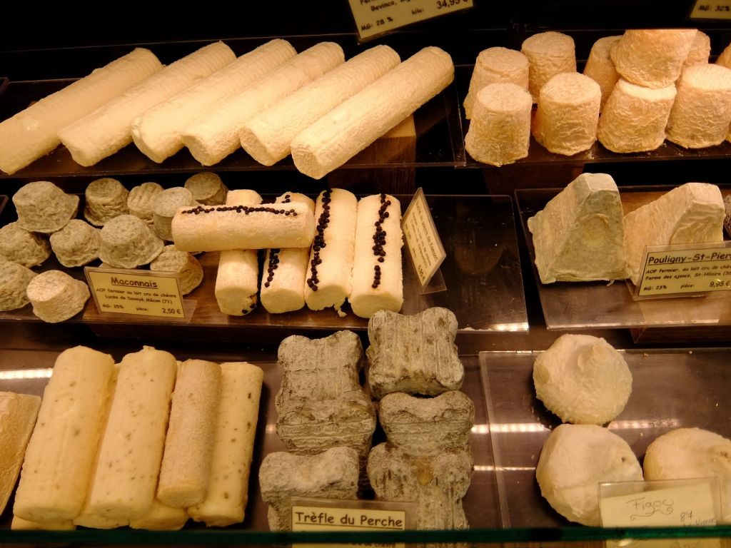 selection of cheeses at a store