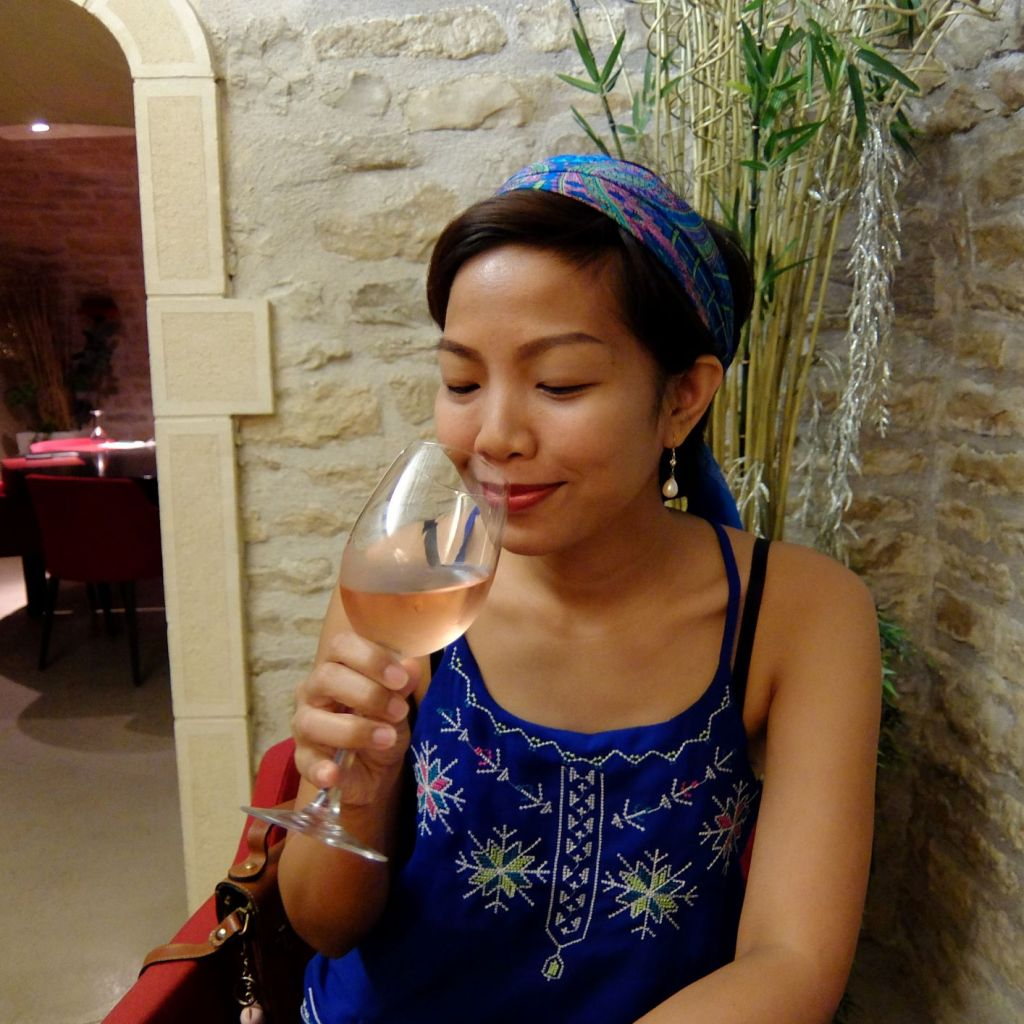 woman drinking a glass of rose