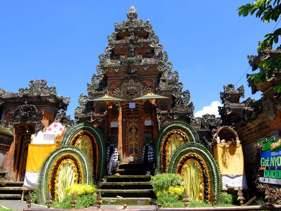 Balinese doorway with colorful decoration in front