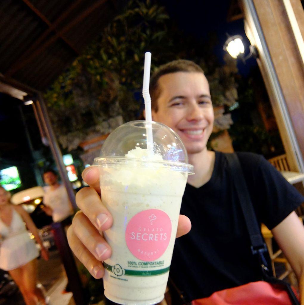 Guy holding vanilla shake